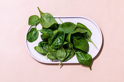 A dish of spinach leaves
