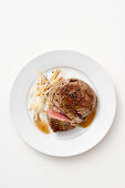 Chateaubriand with a sweet-and-sour sauce and julienned pears