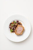 Pork fillet in a hazelnut crust with a raisin and onion sauce
