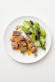 Beef steal skewers with vegetable pesto and a green salad