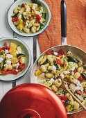 Brightly coloured gnocchi with vegetables