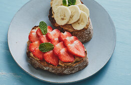 Pan-fried bread topped with peanut butter, strawberries and banana