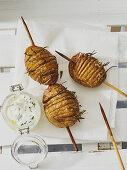 Hasselback potatoes with herb quark