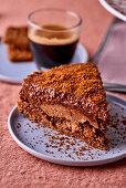 A slice of chocolate cake and coffee