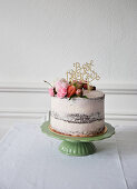 A naked cake decorated with flowers