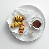 Various mini croissants with hot chocolate