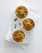 Spaghetti nests with a lamb and pepper sauce and broad beans