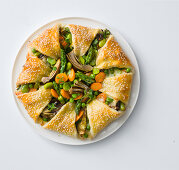 A flower shaped vegetable cake with sesame seeds