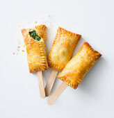 Herb and spinach pastries on sticks