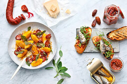 Polenta and cheese gnocchi with chorizo and sage, and bruschetta with dried tomato and date pesto and tinned fish