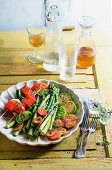 asparagus and tomato salad with grilled melon skewers