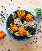 A bowl with lentils, carrots, mushrooms and cashew nut cream