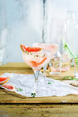 A Gin Fizz with pink grapefruit and marjoram