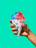 Hand holding snow cone