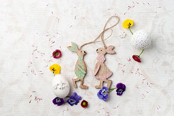 Wooden Easter bunnies with tufted pansies and daisies