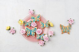 Butterfly biscuits decorated with icing and paper rose