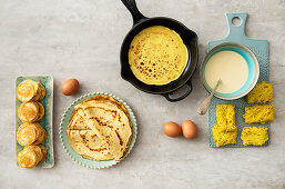 An arrangement of pancakes with crepes, blinis and Malaysian roti jala