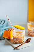 Mango and pumping smoothie on a glass