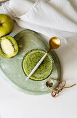 Healthy green smoothie on stone table of spinach, apple avocado and kiwi with lemon juice