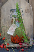 Homemade rosehip essence in a clip top bottle