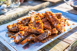 Cooked spare ribs marinated with BBQ sauce