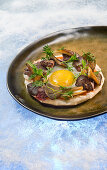 Natural cuisine: fried egg with chicken liver and wild mushrooms