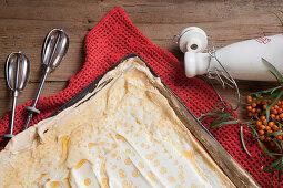Sea buckthorn tray bake cake with meringue