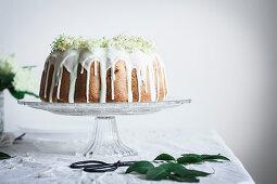 Rhubarb Elderflower Bundt cake with white chocolate glaze