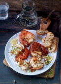 Grilled prawns with grilled bread and lemons