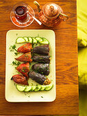 Stuffed peperoni and aubergines with sliced cucumber