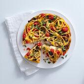 Bucatini frittata with tomatoes, mozzarella and eggplant
