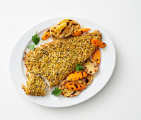 Trout fillet in a pistachio coating with grilled vegetables