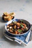 Mediterranean mussels in white wine with kalamata olives, tomatoes, feta cheese and basil