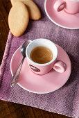 Hot espresso in a pink espresso cup