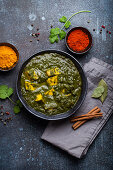 Palak paneer, traditional vegetarian Indian dish with cheese paneer, pureed spinach and spices