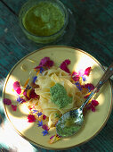Pasta with pesto and edible flowers
