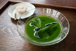 Matcha with ice cubes, served with Wagashi (Japan)