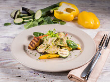 Wholegrain ravioli with grilled potatoes, vegetables and chervil