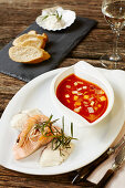 Bouillabaisse and salmon, served with king prawns and cod with rosemary