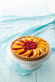 Summer tart with peaches and raspberries