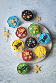 Muffins decorated with stars and rockets for a Moon Landing party