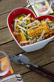 Corn salad with butter, coriander and parmesan shavings