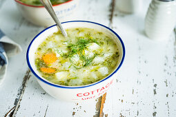 Simple polish style kohlrabi and dill soup in two vintage bowls