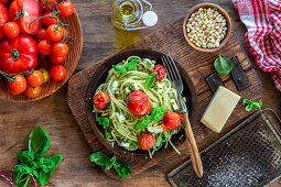 Spaghetti with pesto and braised tomatoes