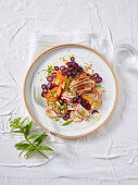 Carrot and apricot salad with marinated vegetables and chicken carpaccio
