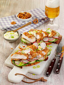 Sandwiches with chicken schnitzel and radishes