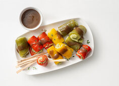 Pepper and tuna fish rolls with a mustard vinaigrette