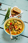 Fish soup with salmon on turquoise background