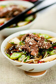 Asian beef soup with mushrooms, chillies and sesame