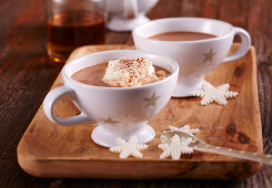 Hot chocolate with rum, vanilla sugar and cream in cups